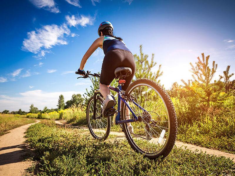 Website Example Bike Shop Women on bicycle